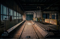An abandoned industrial interior in dark colors