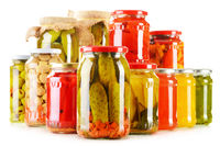 Composition with jars of pickled vegetables isolated on white. Marinated food