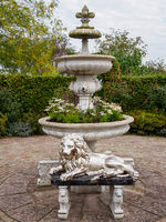 Lion statue in front of fountain