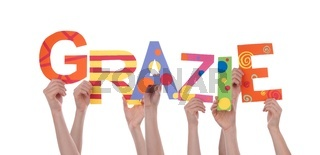 Many Hands Holding the Colorful Italian Word Grazie Which Means Thanks