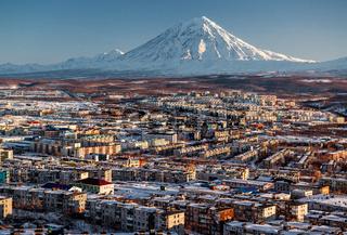 Petropavlovsk-Kamchatsky cityscape and Koryaksky volcano at sunrise. Far East, Russia