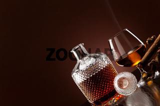 A fine alcohol and a smoking cigar