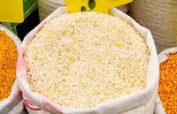 Cracked Corn Kernels In A Sack
