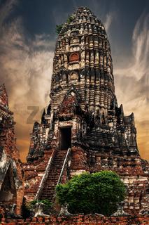 Asian religious architecture. Ancient Buddhist pagoda ruins at Chai Watthanaram temple under sunset sky. Ayutthaya, Thailand travel landscape and destinations