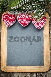 Christmas tree decorations border on vintage wooden blackboard