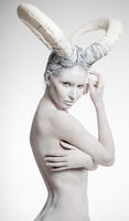 Naked woman with goat body-art