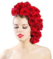 Portrait of smiling girl with red roses hairstyle isolated on white