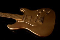 Gold electric guitar on a dark background