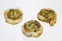Puff pastry pinwheels with wild garlic