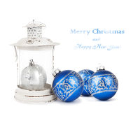 Blue and silver Christmas balls and vintage lantern isolated on white background