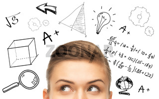 close up of woman looking to mathematical doodles
