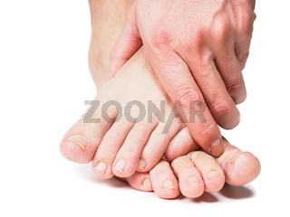 Male person holding onto feet