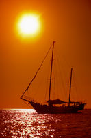 Silhouette of sailing yacht in the tropical sea at sunset. Thailand