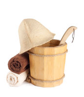 Wooden bucket with ladle and towels for the sauna Isolated on white background