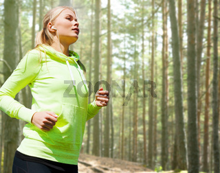 happy woman running or jogging