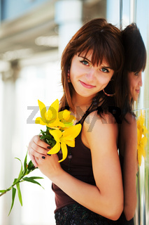 Happy young woman with a flowes