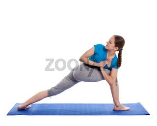 Yoga - young beautiful woman  yoga instructor doing Revolved Side Angle Pose (Parivrtta Parsvakonasana) exercise isolated on white background