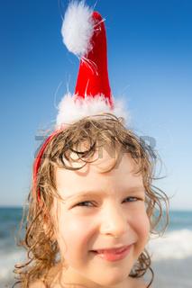 Funny closeup portrait of baby in Santa hat