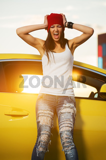 Angry fashionable punk woman standing at the car