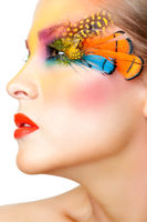 Woman with false feather eyelashes makeup