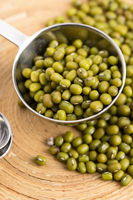 Mung beans over wooden spoon