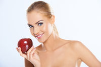 Bare Attractive Woman Holding Dark Red Apple