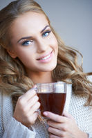 Smiling attractive woman with a mug of coffee