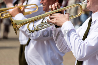 Musicians with trumpets