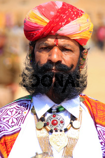 Portrait of indian man taking part in Mr Desert competition, Jaisalmer, India