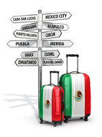 Travel concept. Suitcases and signpost what to visit in Mexico.