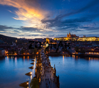 Night aerial view of Prague castle and Charles Bridge over Vltava river in Prague