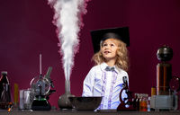 Surprised cute girl looking at evaporation reagent