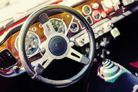 Dashboard and steering wheel of a vintage car