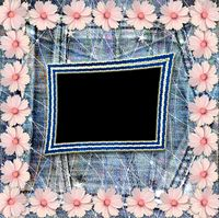 Old vintage postcard with beautiful pink flowers on blue jeans background