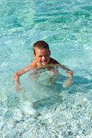 Boy bathing in the sea. (Greece).