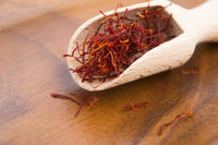 stigmas of saffron in wooden spoon