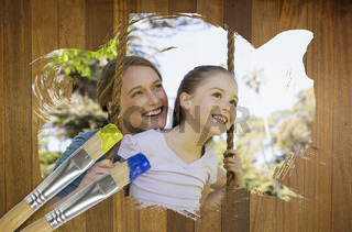 Composite image of mother and daughter in the park