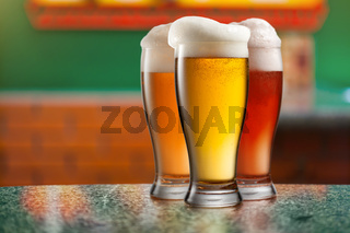 Different beer in glasses in pub