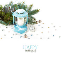 Snowy blue lantern and Christmas balls on the background of fir branches
