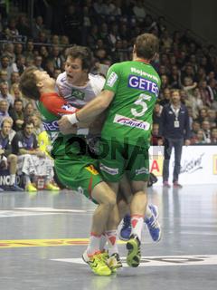 Hans Lindberg (HSV) im Zweikampf DKB Handball-Bundesliga 13/14 29.Spieltag,SC Magdeburg-HSV Handball