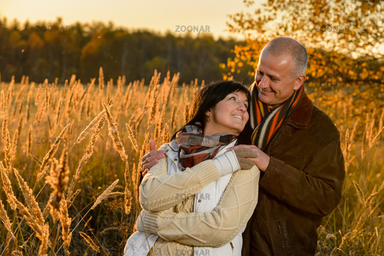 Couple in love embracing in autumn sunset