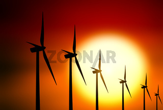 Wind turbine at sunset background