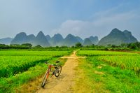 biking on Li river mountain landscape in Yangshuo Guilin