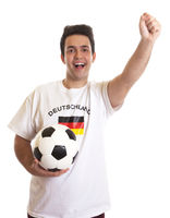 Cheering german soccer fan with football