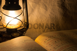 Set with an old rusty lantern and a book