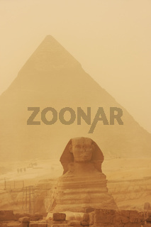 The Sphinx and Pyramid of Khafre in a sand storm, Cairo