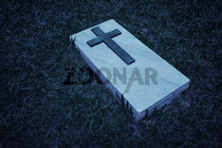 Grave marker at a cemetery in Singapore, in black and white