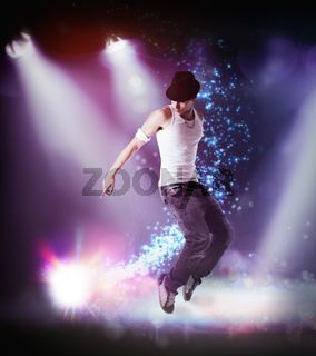 Man in a hat hip hop dancing on a stage