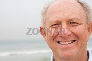 Happy old man posing to camera