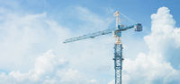 Tall Construction Crane Stands Against a Cloudy Sky